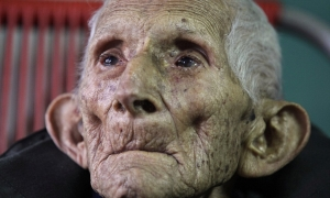 Ignacio Cubilla Banos sits in his house during his 111th birthday celebration in Havana